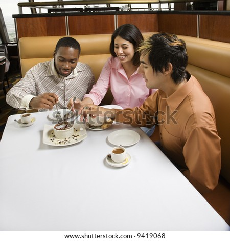 stock photo : Small group of mid adult friends sharing dessert at a ...