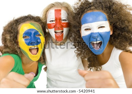 Small group of screaming, international sport's fans with painted flags on faces and with clenched fists. Looking at camera. Front view, white background