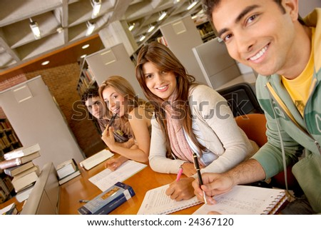Small group of students at a library studying