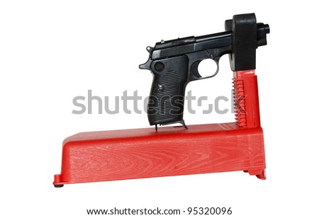 small gun rest supporting a semi-auto pistol with clipping path at original size