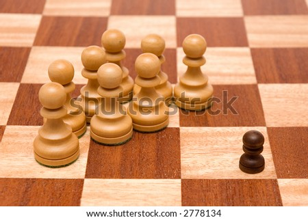 small guy in a very unbalanced situation - stock photo