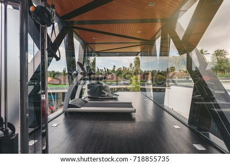 Small gym in Luxury villa, big windows, tropical view