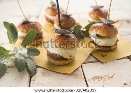 Small hamburger meat and cheese with sage leaves