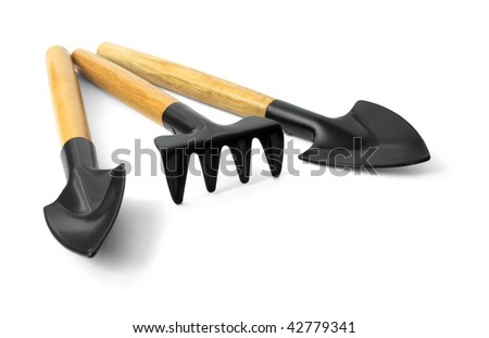 small hand garden tools isolated on white