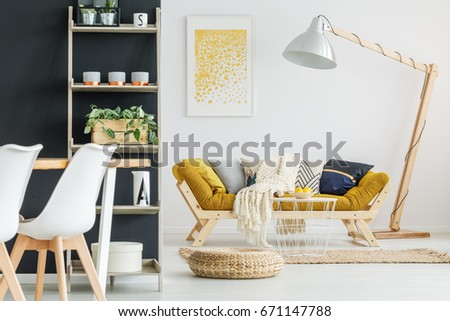 Small hand-made stylish table with bowl of lemons #671147788