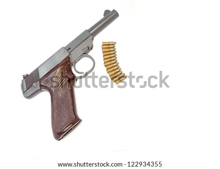 Small handgun with bullets. Profile of a .22 caliber gun with decorative grip. Thirteen shiny bullets just below the gun. Isolated on a white background. Horizontal view.