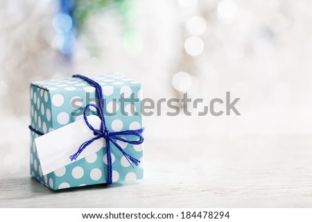 Small handmade gift box over shiny ornaments #184478294