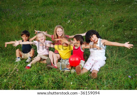 Small happy little group of children outdoor