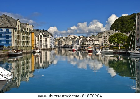 Small harbor in downtown of Alesund, Norway