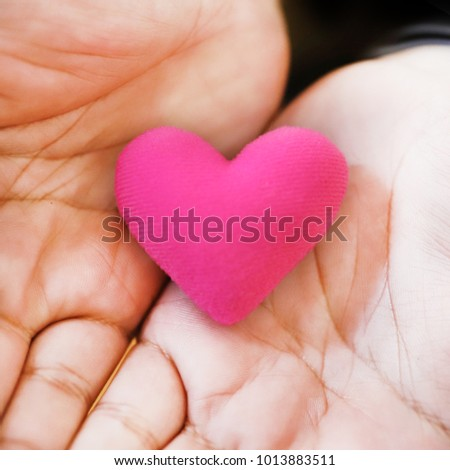 Small heart in hand.Love and care.With love and care.Soft focus. #1013883511