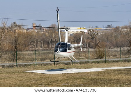 Shutterstock Small helicopter flying low over the ground