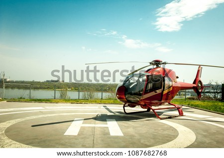 Small helicopter parked at the helipad. Luxury lifestyle