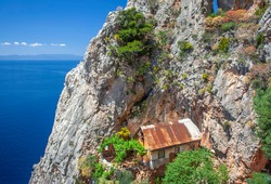 Small hermitage in rocks high above orthodox monastery on Mount Athos, Chalkidiki, Greece