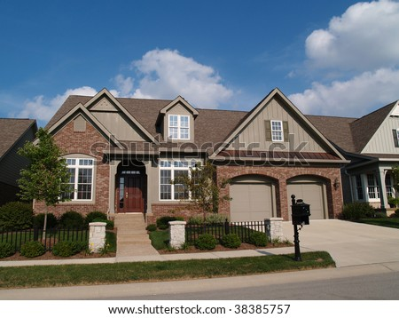 Small home with double garage in a neighborhood where the houses are built close together with - Small houses with built in garage ...