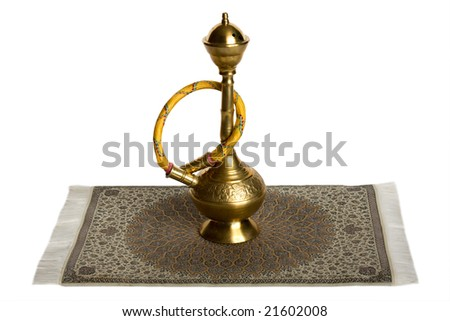Small hookah on Iranian rug. Isolated on white.