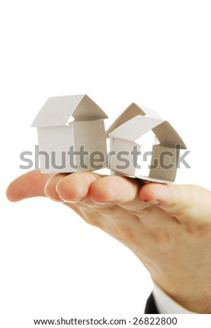 Small house from a paper in a hand