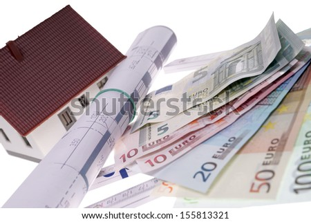 small house with architectural drawing and euro banknotes / home construction