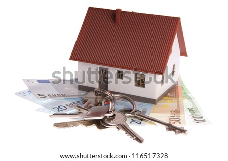 small house with banknotes and house keys / dream of own house