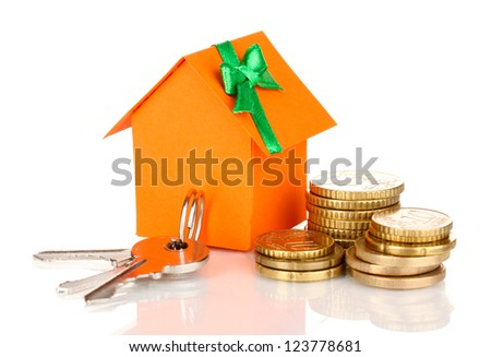 Small house with money and key isolated on white - stock photo