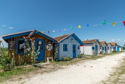 Small houses in the old oyster and fishing port of Talais, on the Gironde estuary in France