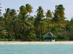 Small Hut on a blue Caribbean Beach on Tobago