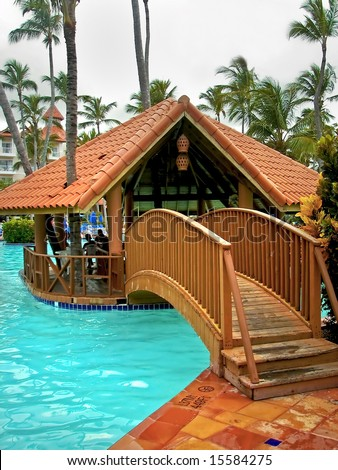 Small Hut That Is In The Middle Of A Large Swimming Pool On A Nice ...