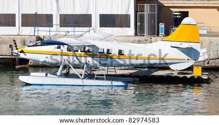 Small hydroplane lying  on water  in dock