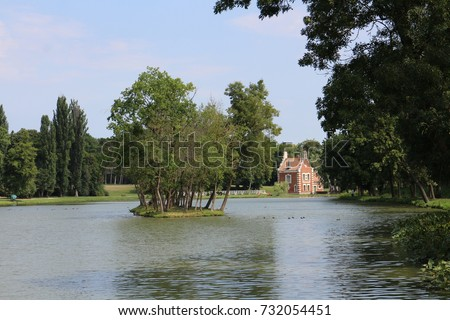 Small island and Holland house (A Holland Ház) on isle in garden of Classicist manor house in Dég, Hungary  Stock fotó ©