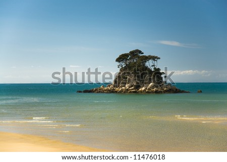 Small island in the ocean, torrent bay, abel tasman national park, new zealand.