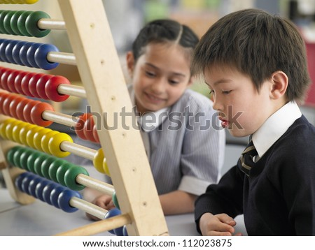Small kids playing with toys together in classroom