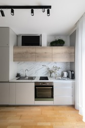 Small kitchen interior with grey cabinets
