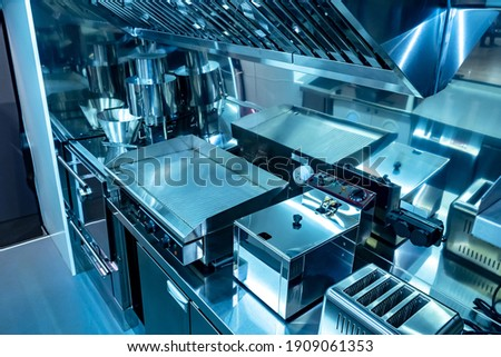 Small kitchen restaurant. Equipment in the restaurant is made of stainless steel. Concept of a mobile cafe. Restaurant kitchen on wheels with industrial equipment. Equipment for cafe on wheels