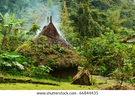 Small kogi hut built in the traditional way of the Tayrona in Northern Colombia. The roof of the hut has to be kept dry as it rains every day in this region, thus the smoke coming through the roof.