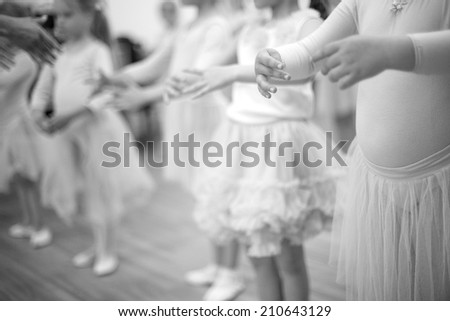 Small ladies training ballet position, mid section;monochrome;