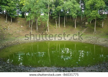 Small lake in meteor crater. - stock photo