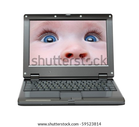 small laptop with baby eyes on screen