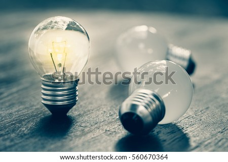 Small light bulb standing and glowing