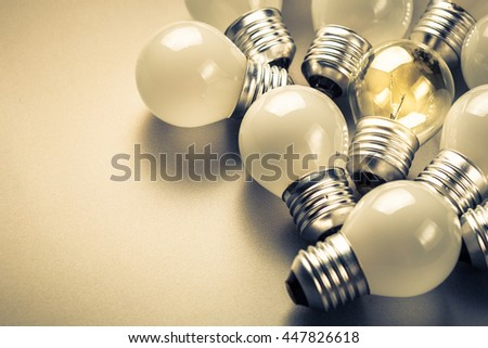 Small light bulbs and the different one glowing in the group, small business, original idea concept #447826618
