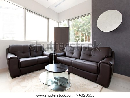 small living room interior with leather furniture stock photo 94320655