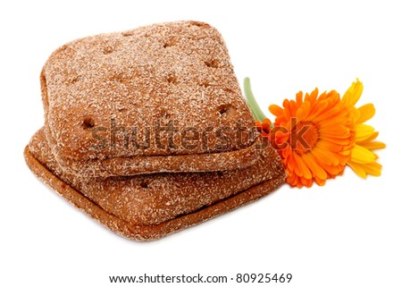 Small loafs Finnish grain and calendula flowers isolated on a white background