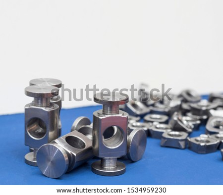 small machined parts manufacturing process ; tapping ; industrial background