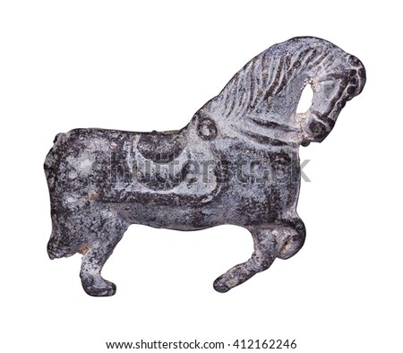 Small metal figure of a horse. Isolated on a white background.