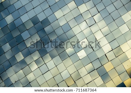 Small mirror decorated on wall background with reflection #711687364