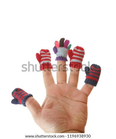 small mittens and gloves dressed on male fingers. isolated on white background. winter time season #1196938930