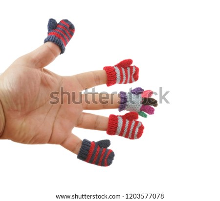 small mittens and gloves dressed on male fingers. isolated on white background. winter time season #1203577078
