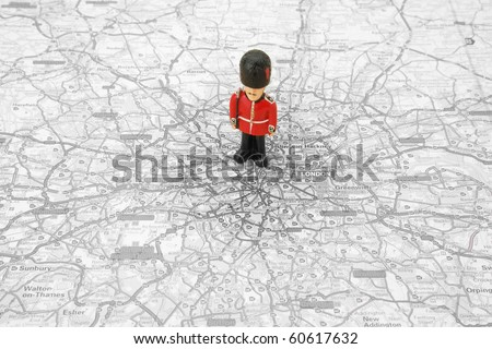 Small Model of a Grenadier Guard on top of a Map of london