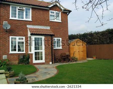 small modern english brick house and garden