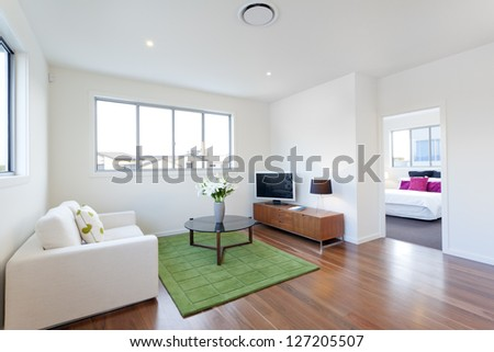 Small modern living room with TV and couch #127205507
