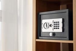 Small modern safe on shelf