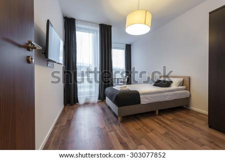 Small, modern sleeping room interior design in scandinavian style